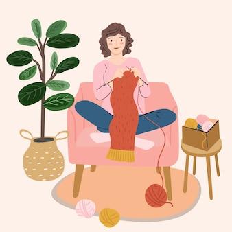 Woman holding knitting needles and yarn knits. knitting hobby. woman activity, profession