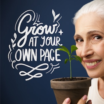 Woman holding a plant lettering