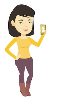 鳴っている携帯電話を保持している女性。