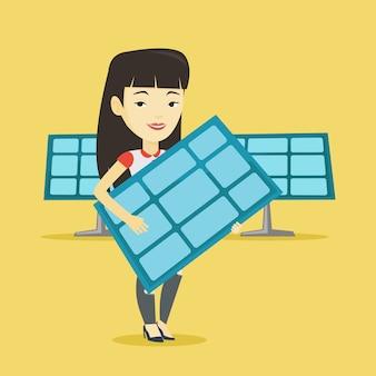Woman holding solar panel.