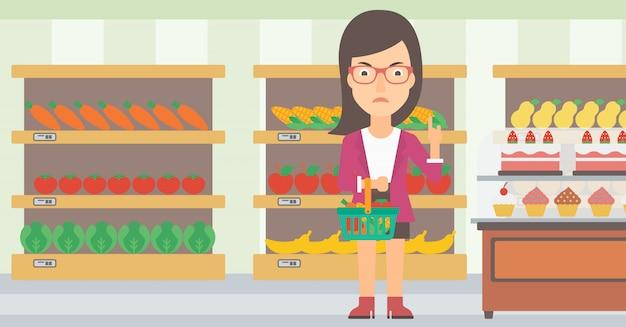 Woman holding supermarket basket.
