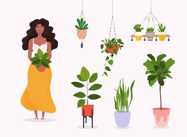 여자는 냄비 그림에서 식물을 보유