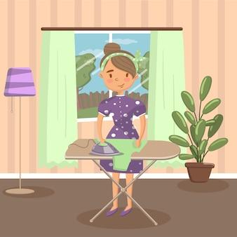 リビングルームの図にあるアイロン台に服をアイロンの女性主婦