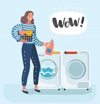 여자 주부 세탁기에 옷을 씻어