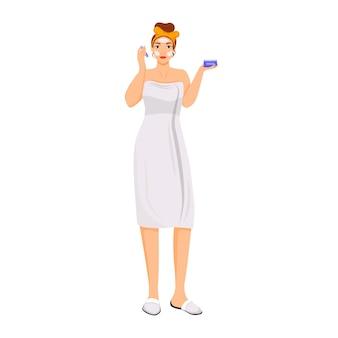 Женщина в халате, применяя бальзам для лица