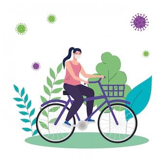 Covid-19 전염병 동안 자연 풍경에 의료 보호 마스크를 사용 하여 자전거에 여자