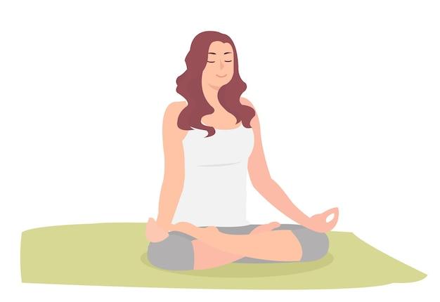 Женщина в позе йоги скрещенными ногами