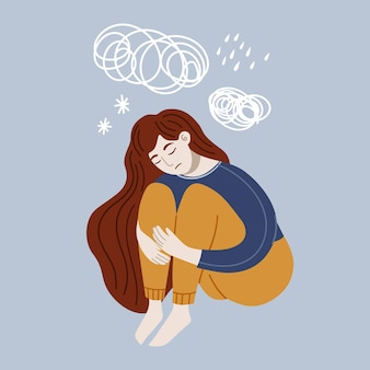 床に座っているうつ病の女性ストレス感絶望孤独精神障害