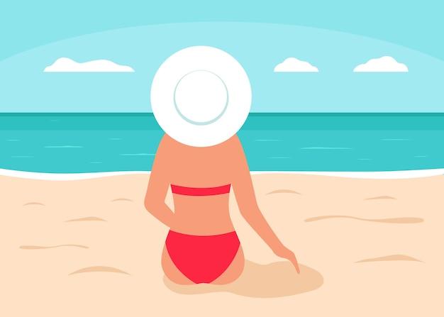 Женщина в красном купальнике сидит на пляже и смотрит на море сзади силуэт девушки в бикини