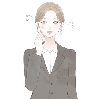 愛想よく笑っているスーツの女性。白い背景に。