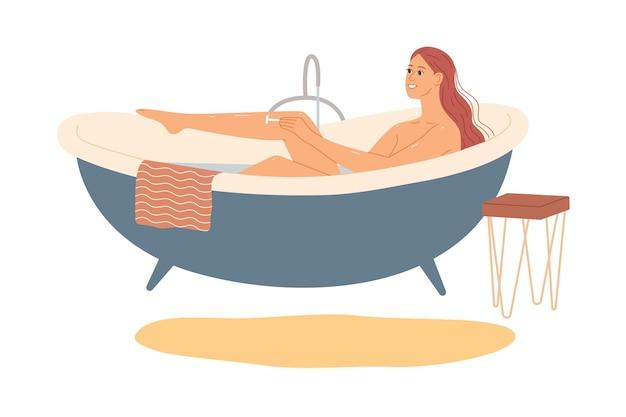 お風呂の女性が足を剃る。