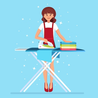 Woman ironing clothes on board. housewife doing domestic work. maid service.