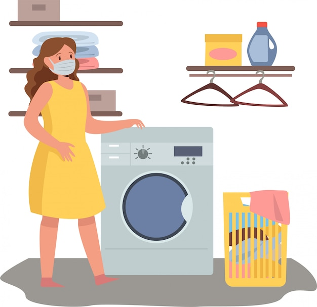 Woman is doing laundry at home while using medical mask