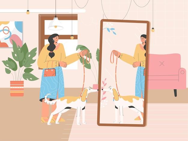 女性は犬と一緒に散歩の準備をしています