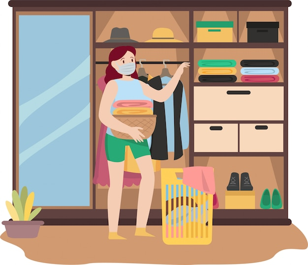 Woman is stacking her clothes after finish washing and ironing it