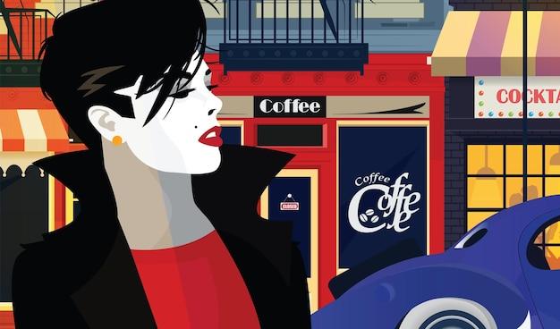 여자는 저녁 도시의 거리를 따라 걷고있다.