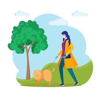 여자는 공원에서 강아지와 함께 산책