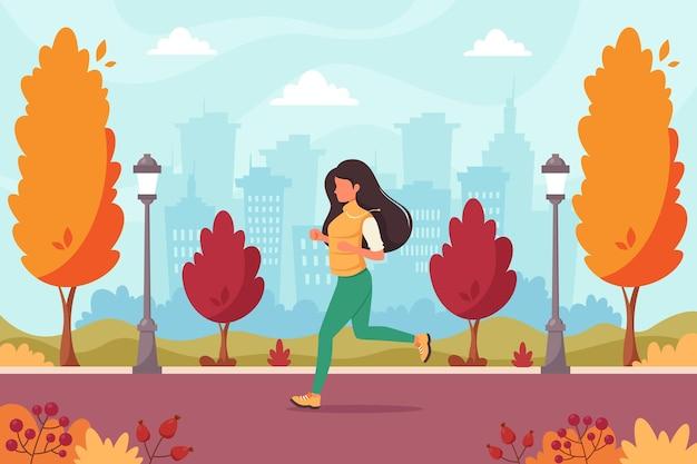 秋の公園でジョギングする女性健康的なライフスタイルスポーツ野外活動