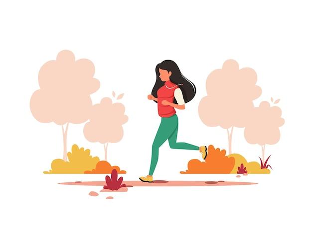 가을 공원에서 조깅하는 여자. 건강한 라이프 스타일, 스포츠, 야외 활동.