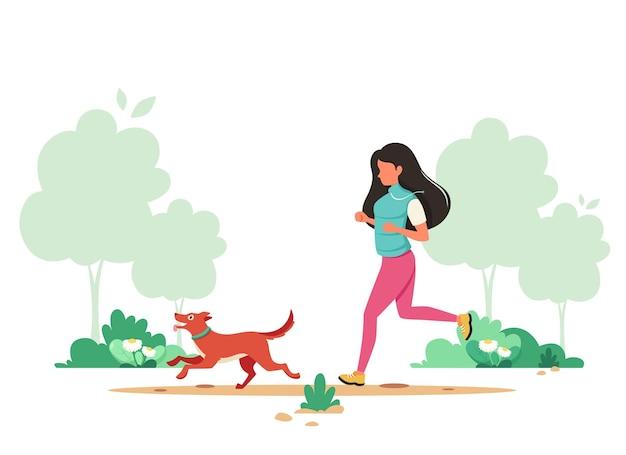 봄에 강아지와 조깅하는 여자. 실외 활동