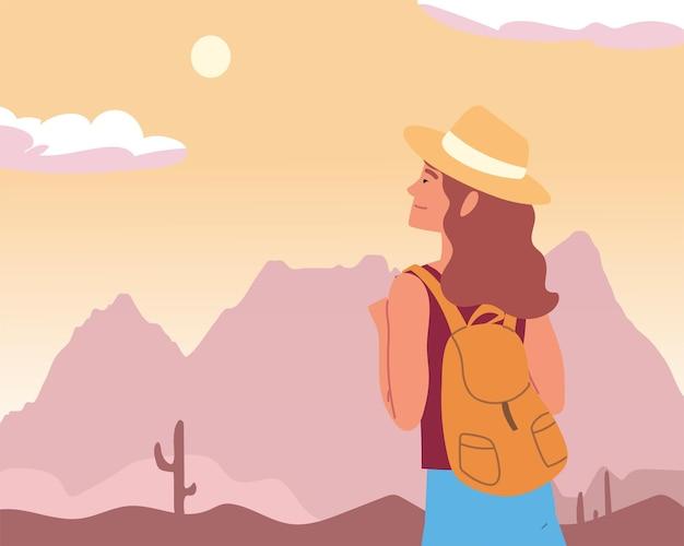 砂漠の風景を見る女性