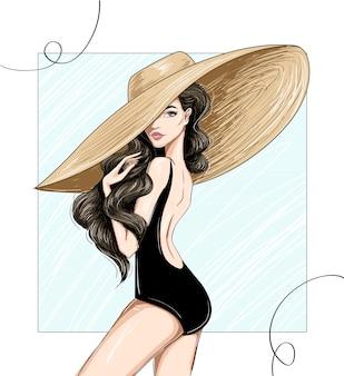 Женщина смотрит со спины в широкой шляпе