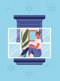 青い家のデザインから窓の外を見て女性