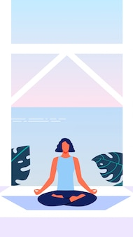 Woman in lotus position on terrace overlooking sea