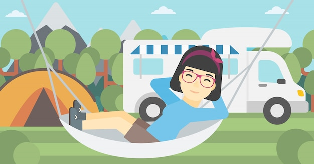 Woman lying in hammock in front of motor home.