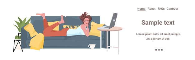 Woman lying on sofa using laptop online communication social networking remote work self isolation concept horizontal copy space