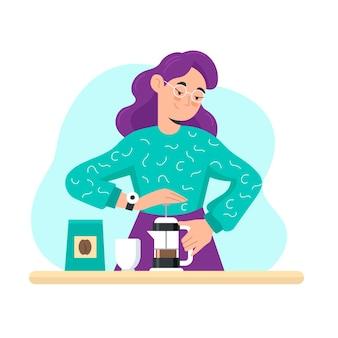 フレンチプレスカフェティエールでコーヒーを作る女性