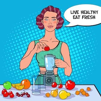 신선한 과일 스무디를 만드는 여자