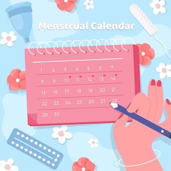Woman marking on her menstrual calendar