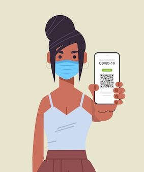 Woman in mask holding digital immunity passport with qr code on smartphone screen risk free covid-19 pandemic vaccinate certificate coronavirus immunity concept vertical portrait vector illustration