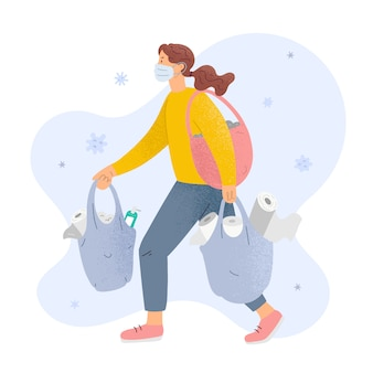 Woman in mask with bags full toilet paper and sanitizers, concept of panic shopping