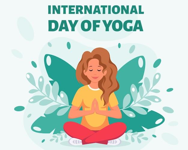 蓮華座で瞑想する女性国際ヨガの日