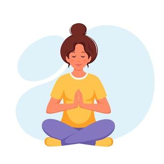 蓮華座で瞑想する女性