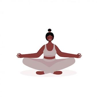 Женщина медитирует в позе лотоса йоги