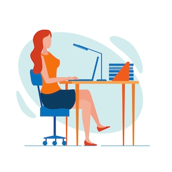 Woman office worker, sitting at desk, working late