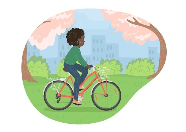 봄 도시 공원에서 자전거 자전거 아프리카 여자에 여자