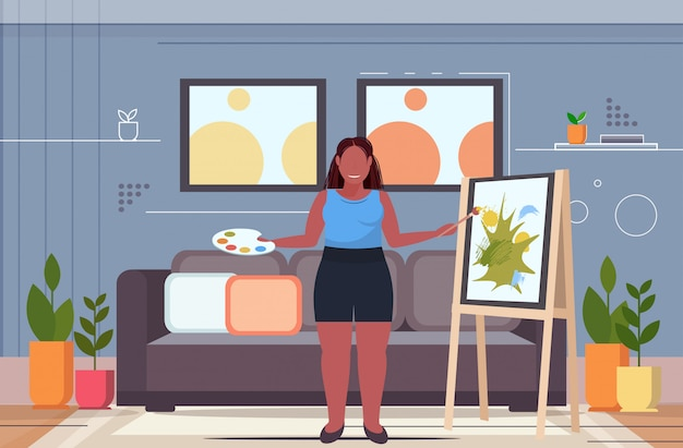 Woman painter using paintbrush  overweight girl artist painting on easel art creativity concept modern living room interior full length flat horizontal