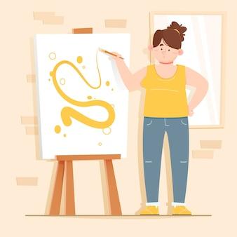 室内のキャンバスにペイントする女性