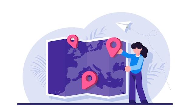 Женщина, размещающая отметку или булавку на карте мира. выбор места назначения международной туристической службы для путешествий за границу.