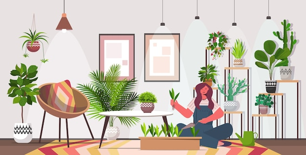 Woman planting houseplants in pot housewife caring of her plants living room interior horizontal