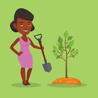 Woman plants tree.