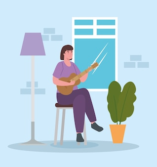 Woman playing guitar at home design of activity and leisure