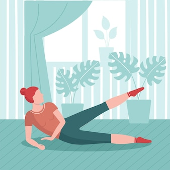 Woman practices yoga at home. home sport concept, online yoga workout indoors.