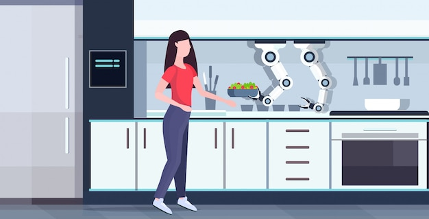 Woman preparing food with smart handy chef robot holding fresh salad kitchen assistant concept automation robotic innovation technology artificial intelligence full length  horizontal