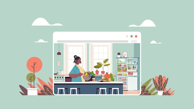 Woman preparing healthy food at home online cooking concept modern kitchen interior web browser window horizontal portrait