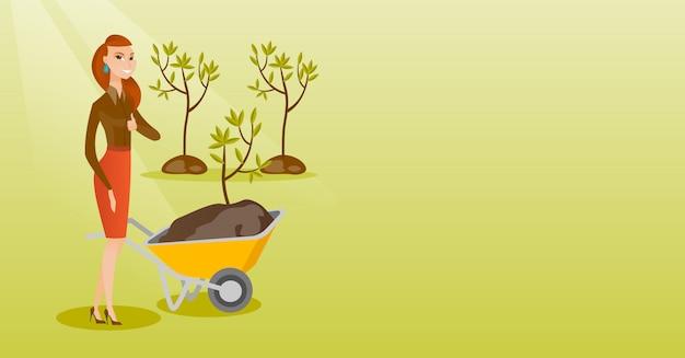 Woman pushing wheelbarrow with plant.